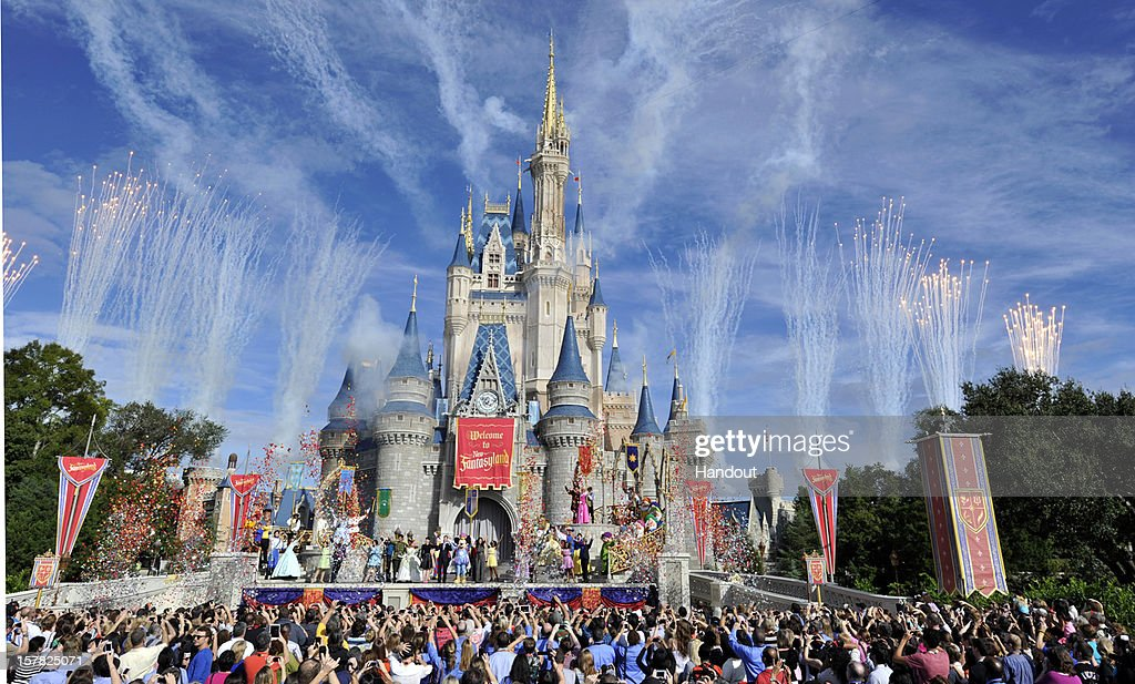 In this handout image provided by Disney Parks fireworks light the sky over Cinderella Castle during the Grand Opening of New Fantasyland at Walt...