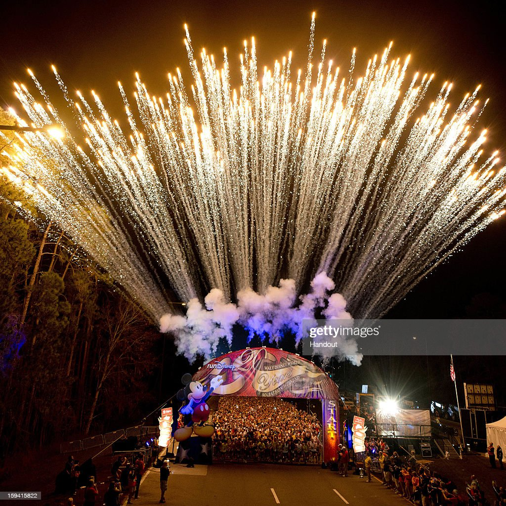 In this handout image provided by Disney Parks, fireworks light the sky January 13, 2013 to mark the official start of the 20th Annual Walt Disney World Marathon presented by Cigna at Walt Disney World Resort in Lake Buena Vista, Fla. The 26.2-mile race coursed through all four Disney theme parks and through the Walt Disney World Speedway and ESPN Wide World of Sports Complex. A record 65,000 runners took part this year in a variety of Walt Disney World Marathon Weekend events, including the Family Fun Run 5K, Mickey Mile and runDisney Kids Races, along with the half and full marathons.