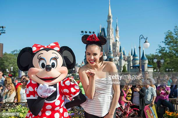 In this handout image provided by Disney Parks Hollywood Records singersongwriter and Disney Channel actress Sofia Carson poses with Minnie Mouse...