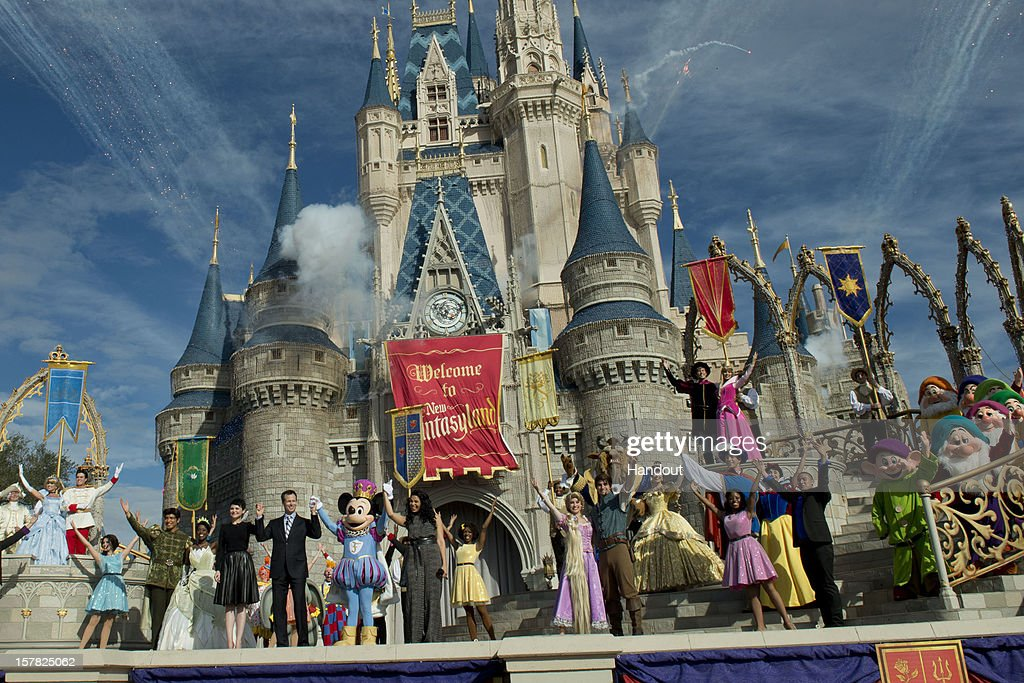In this handout image provided by Disney Parks, it was a celebratory spirit at Cinderella Castle during the Grand Opening of New Fantasyland at Walt Disney World Resort December 6, 2012 in Lake Buena Vista, Florida. Actress <a gi-track='captionPersonalityLinkClicked' href=/galleries/search?phrase=Ginnifer+Goodwin&family=editorial&specificpeople=215039 ng-click='$event.stopPropagation()'>Ginnifer Goodwin</a>, Disney Parks and Resorts Chairman Tom Staggs, singer <a gi-track='captionPersonalityLinkClicked' href=/galleries/search?phrase=Jordin+Sparks&family=editorial&specificpeople=4165535 ng-click='$event.stopPropagation()'>Jordin Sparks</a> and Mickey Mouse joined dozens of Disney characters on Cinderella Castle stage to celebrate the opening. New Fantasyland is a new area in the Magic Kingdom and is the largest expansion in the 41-year history of the theme park.