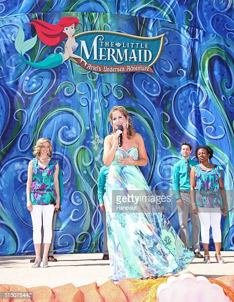 In this handout image provided by Disney Parks Jodi Benson performs 'Part of Your World' during the grand opening ceremony for 'The Little Mermaid ~...