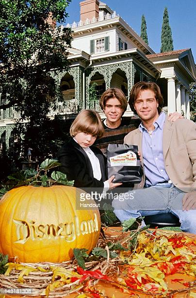 In this handout image provided by Disney Parks Joey Lawrence and his brothers Matthew Lawrence and Andrew Lawrence pose outside the Haunted Mansion...
