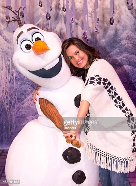In this handout image provided by Disney Parks Mariska Hargitay meets Olaf the snowman at 'Olaf's Snow Fest' at Disney California Adventure park part...