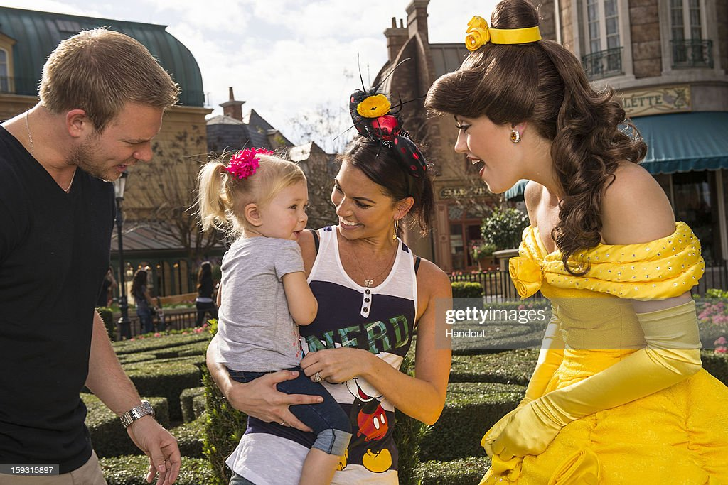 In this handout image provided by Disney Parks, Melissa Rycroft (C), the most recent winner of ABC's 'Dancing with the Stars' and former contestant on 'The Bachelor,' her husband Tye Strickland (L) and their daughter Ava meet Princess Belle from Disney's 'Beauty and the Beast' at the France pavilion in the Epcot theme park January 11, 2013 in Lake Buena Vista, Florida. Epcot is one of four theme parks at Walt Disney World Resort.