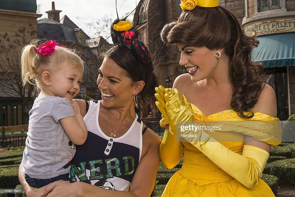 In this handout image provided by Disney Parks, <a gi-track='captionPersonalityLinkClicked' href=/galleries/search?phrase=Melissa+Rycroft&family=editorial&specificpeople=5761590 ng-click='$event.stopPropagation()'>Melissa Rycroft</a> (C), the most recent winner of ABC's 'Dancing with the Stars' and former contestant on 'The Bachelor,' and her daughter Ava meet Princess Belle from Disney's 'Beauty and the Beast' at the France pavilion in the Epcot theme park January 11, 2013 in Lake Buena Vista, Florida. Epcot is one of four theme parks at Walt Disney World Resort.