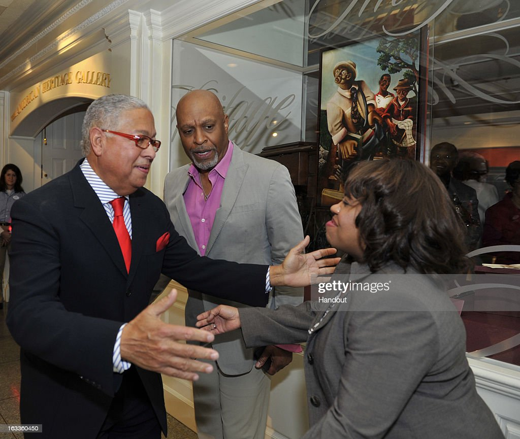 In this handout image provided by Disney Parks, philanthropist Bernard Kinsey (L) greets 'Grey's Anatomy' stars James Pickens, Jr. (C) and Chandra Wilson (R) at the premiere of 'Re-Discovering America: Family Treasures from the Kinsey Collection,' a new art exhibit in Epcot at Walt Disney World Resort March 8, 2013 in Lake Buena Vista, Florida. The exhibit, inside the theme park's American Heritage Gallery, celebrates 400 years of African-American achievement and contribution. Pickens and Wilson are two of the celebrities that recorded narration for guests to hear in the immersive exhibit. The collection consists of of rare art, documents, books and artifacts amassed by philanthropists Bernard and Shirley Kinsey, who share a passion for African-American history.