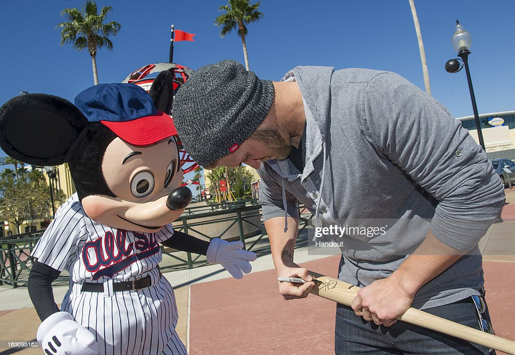 In this handout image provided by Disney Parks, reigning National League Rookie of the Year Bryce Harper of the Washington Nationals signs an autograph for Mickey Mouse at ESPN Wide World of Sports Complex March 4, 2013 at Walt Disney World in Lake Buena Vista, Florida. Harper also was named to the 2012 NL All-Star Team. The Washington Nationals are hosting their MLB Spring Training in nearby Viera, Florida.