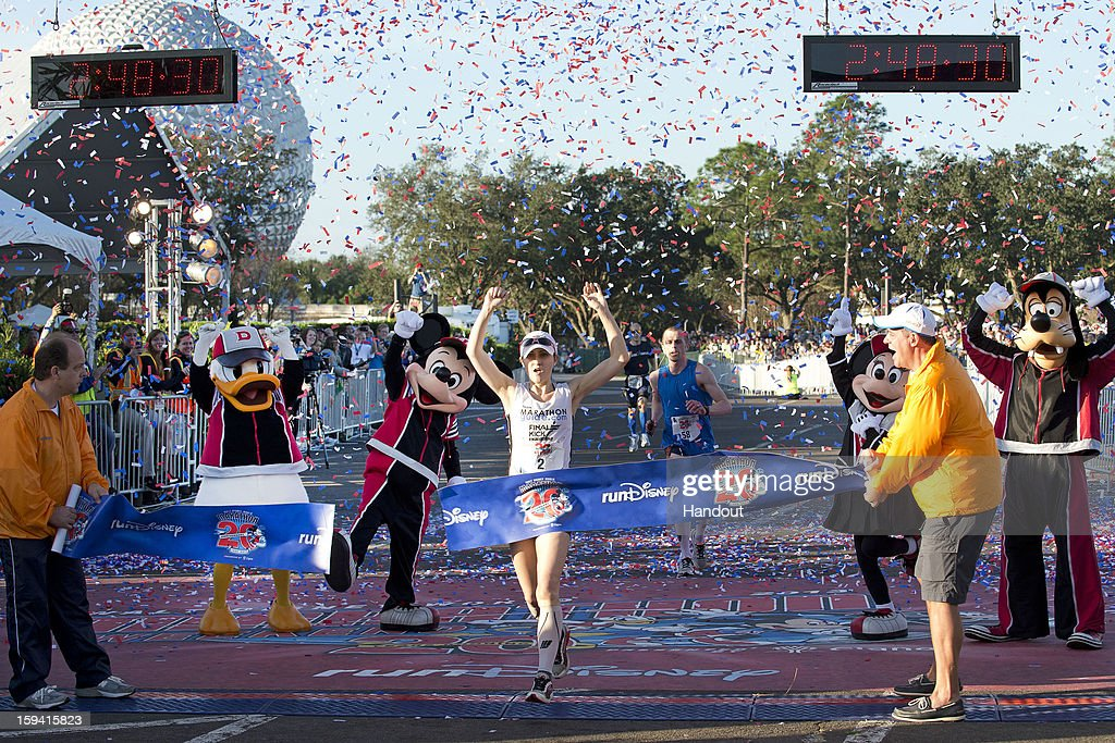 In this handout image provided by Disney Parks, Renee High of Virginia Beach, Va., crosses the finish line to claim her second consecutive Walt Disney World Marathon women's title January 13, 2013 with a time of 2:48:30 at the 20th Annual Walt Disney World Marathon presented by Cigna at Walt Disney World Resort in Lake Buena Vista, Fla. The 26.2-mile race coursed through all four Disney theme parks and through the Walt Disney World Speedway and ESPN Wide World of Sports Complex. A record 65,000 runners took part in a variety of Walt Disney World Marathon Weekend events, including the Family Fun Run 5K, Mickey Mile and runDisney Kids Races, along with the half and full marathons.