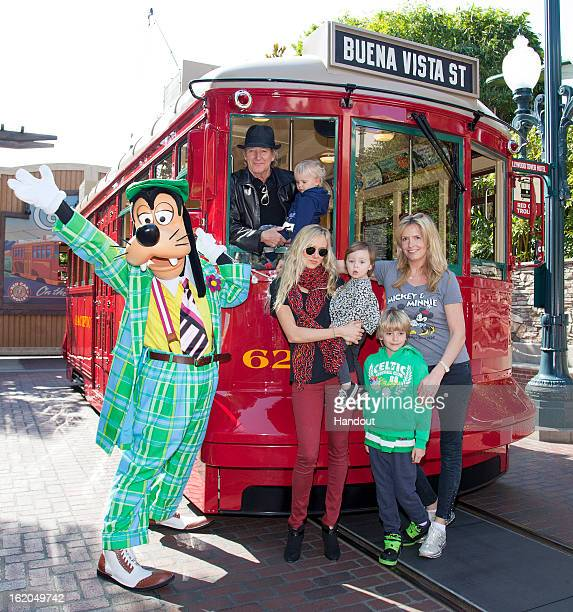 In this handout image provided by Disney Parks Rod Stewart his wife Penny and their sons Aiden and Alastair 7 celebrate Aiden's second birthday along...