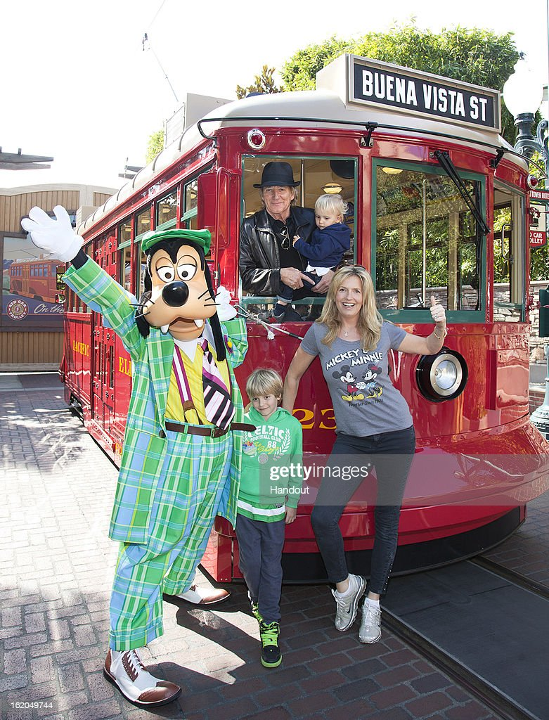 In this handout image provided by Disney Parks, <a gi-track='captionPersonalityLinkClicked' href=/galleries/search?phrase=Rod+Stewart&family=editorial&specificpeople=160467 ng-click='$event.stopPropagation()'>Rod Stewart</a>, his wife Penny, and their sons, Aiden, 2, and Alastair 7, celebrate Aiden's second birthday with Goofy on the Red Car Trolley at Disney California Adventure park February 18, 2013 in Anaheim, California.