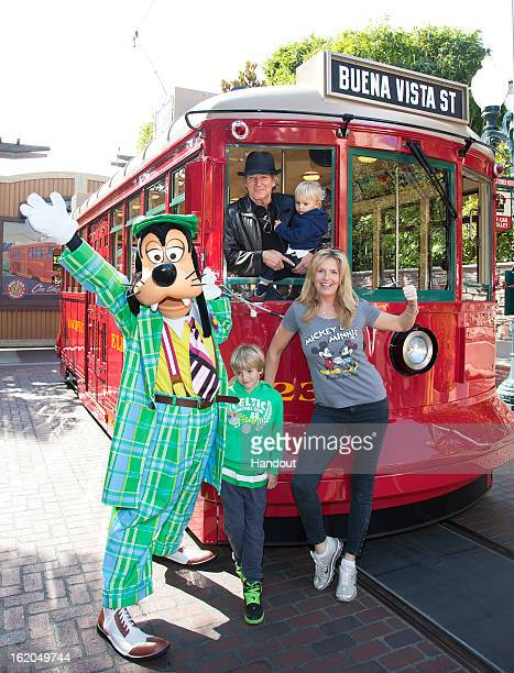 In this handout image provided by Disney Parks Rod Stewart his wife Penny and their sons Aiden and Alastair 7 celebrate Aiden's second birthday with...