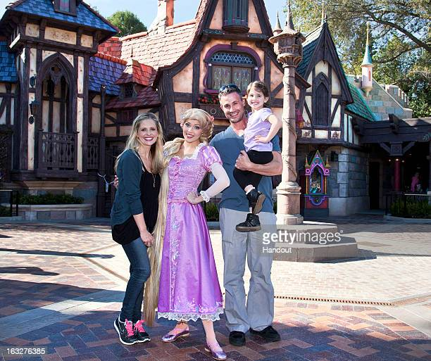 In this handout image provided by Disney Parks Sarah Michelle Gellar Freddie Prinze Jr and their daughter Charlotte meet Rapunzel at the allnew...