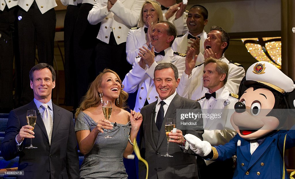 In this handout image provided by Disney Parks singer Mariah Carey joins Walt Disney Company President and CEO Robert A Iger Walt Disney Parks and...