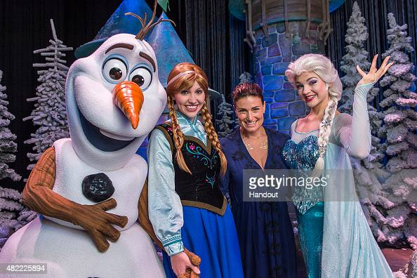 In this handout image provided by Disney Parks Tony Awardwinning actress and singer Idina Menzel poses on July 28 2015 with Elsa Anna and Olaf from...