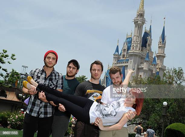 In this handout image provided by Disney Taylor York Zac Farro Josh Farro Jeremy Davis and Hayley Williams of the band Paramore pose at the Magic...