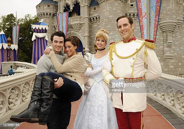 In this handout image provided by Disney to celebrate their first wedding anniversary Kevin Jonas of the pop trio 'Jonas Brothers' and his wife...