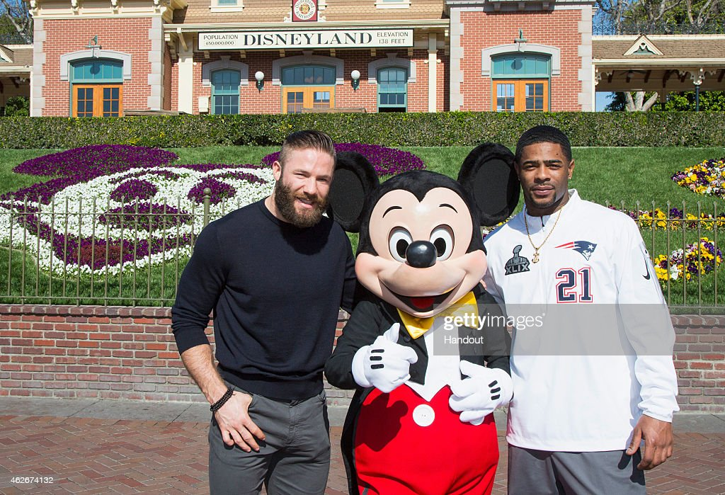 In this handout image provided by Disneyland, New England Patriots players <a gi-track='captionPersonalityLinkClicked' href=/galleries/search?phrase=Julian+Edelman&family=editorial&specificpeople=4489543 ng-click='$event.stopPropagation()'>Julian Edelman</a> (left) and <a gi-track='captionPersonalityLinkClicked' href=/galleries/search?phrase=Malcolm+Butler&family=editorial&specificpeople=12913602 ng-click='$event.stopPropagation()'>Malcolm Butler</a> were greeted by Mickey Mouse as they celebrated their team's Super Bowl XLIX championship victory with a special visit to Disneyalnd park in Anaheim, Calif., on Monday. In the frenzied moments following their team's feat of capturing the National Football League championship on Sunday, Edelman and Butler stood in front of a TV camera and shouted four words that have become an iconic reaction to milestone achievement: 'We're going to Disneyland!'