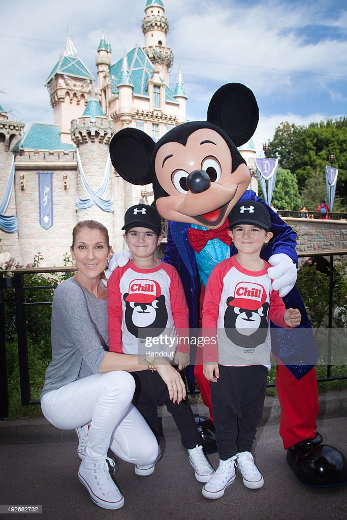 In this handout image provided by Disneyland Resort, Celine Dion and twin sons Eddy (L) and Nelson, age 4, celebrate the boys' upcoming fifth birthday with Mickey Mouse at Disneyland park in Anaheim, Calif. on Wed. The Disneyland Resort Diamond Celebration celebrates 60 years of magic now through September 5, 2016.