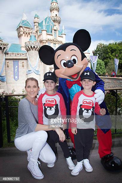 In this handout image provided by Disneyland Resort Celine Dion and twin sons Eddy and Nelson age 4 celebrate the boys' upcoming fifth birthday with...