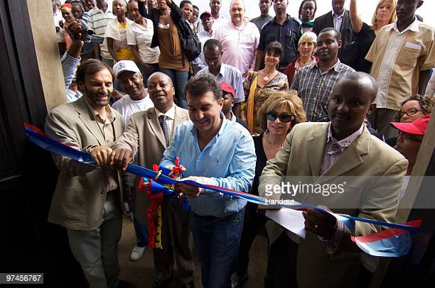 In this handout image provided by FC Barcelona President of FC Barcleona Joan Laporta formally opens the new multifunctional centre at the UNHCR...