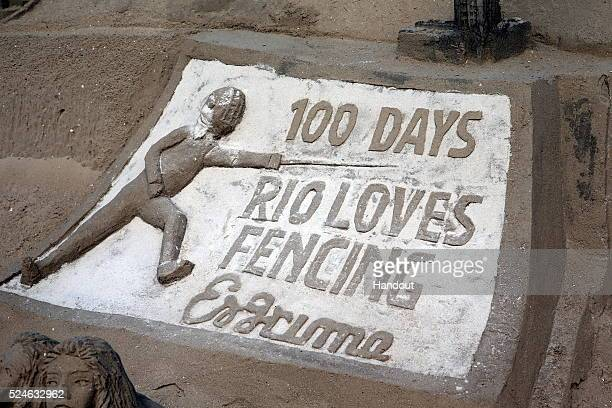 In this handout image provided by FIE a Copacabana Beach sand castle displays the 100 Days to Rio mark which occurs on April 27 and indicating the...