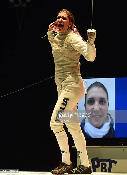 In this handout image provided by FIE Arianna Errigo of Italy celebrates against Aida Shanaeva of Russia during the final of the women's foil...