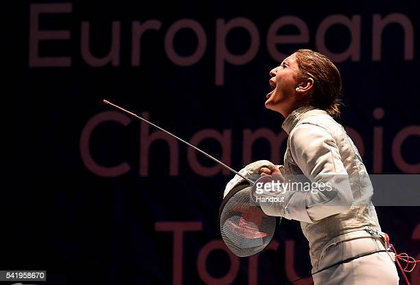 In this handout image provided by FIE Arianna Errigo of Italy celebrates against Larissa Korobeynikova of Russia during the semifinal of the women's...