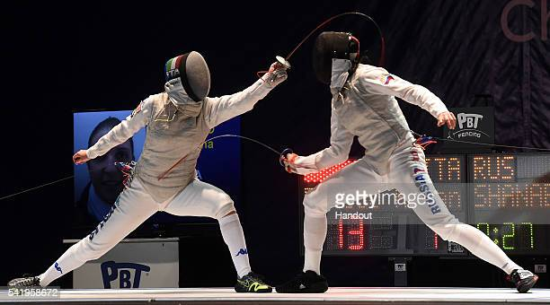 In this handout image provided by FIE Arianna Errigo of Italy competes with Aida Shanaeva of Russia during the final of the women's foil competition...