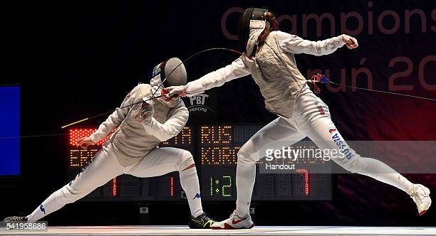 In this handout image provided by FIE Arianna Errigo of Italy competes with Larissa Korobeynikova of Russia during the semifinal of the women's foil...