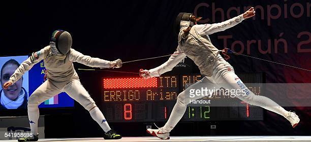 In this handout image provided by FIE Arianna Errigo of Italy competes with Larissa Korobeynikova of Russia during the semi final of the women's foil...
