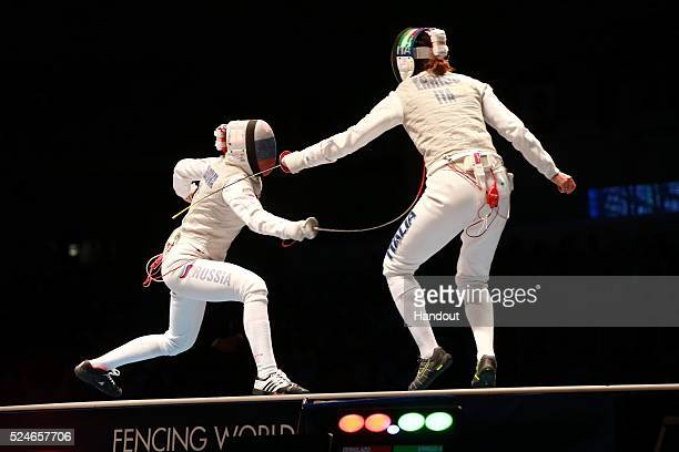 In this handout image provided by FIE at the fencing team world championships in Rio de Janeiro Italy's Arianna Errigo is scored on by Russi's Inna...
