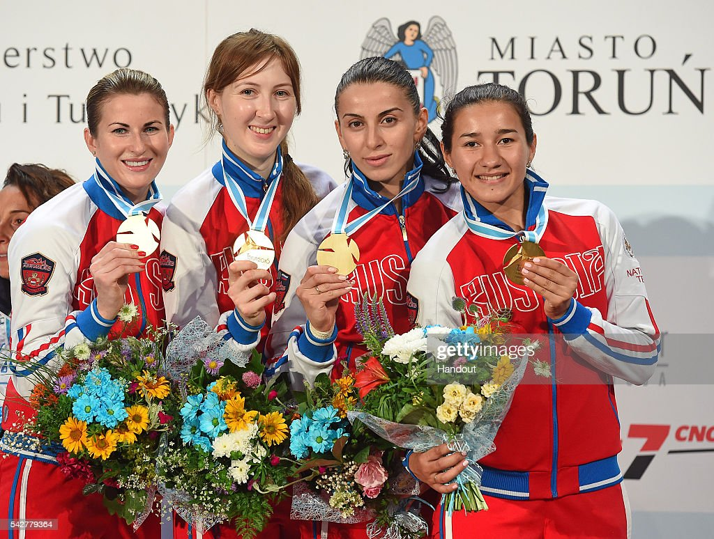 In this handout image provided by FIE, Inna Deriglazoka, Larisa Korobeynikova, Aida Shanaeva, Adelina Zagidullina of Russia show off their medals during the ceremony of women's foil team European Fencing Championships on June 24, 2016 in Torun, Poland. (Photo by Augusto Bizzi/FIE via Getty Images).