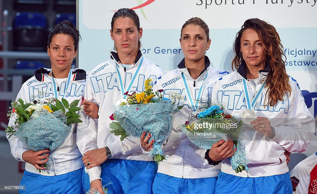 In this handout image provided by FIE, Martina Batini, Elisa Di Francisca, Arianna Errigo, and Alice Volpi of Italy stand with their medals during the ceremony of women's foil team European Fencing Championships on June 24, 2016 in Torun, Poland. (Photo by Augusto Bizzi/FIE via Getty Images).