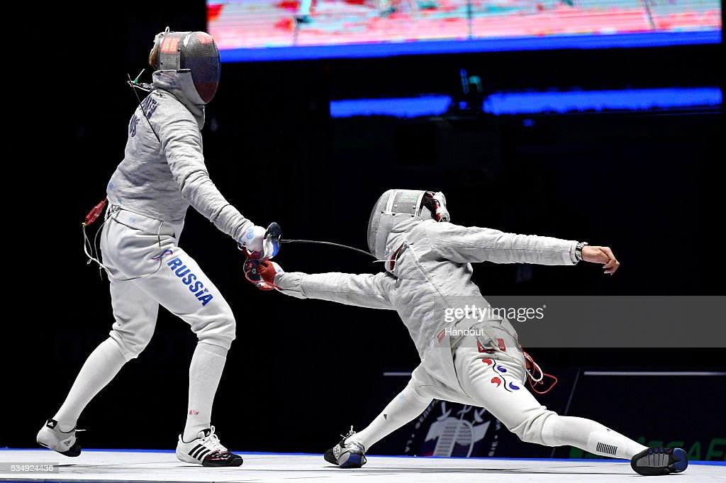 In this handout image provided by FIE, Nikolay Anatolyevich Kovalev of Russia and Kim Jung-hwan of South Korea compete in their Men's Individual Sabre semi-final during the FIE Moscow Grand Prix on May 28, 2016 in Moscow, Russia.