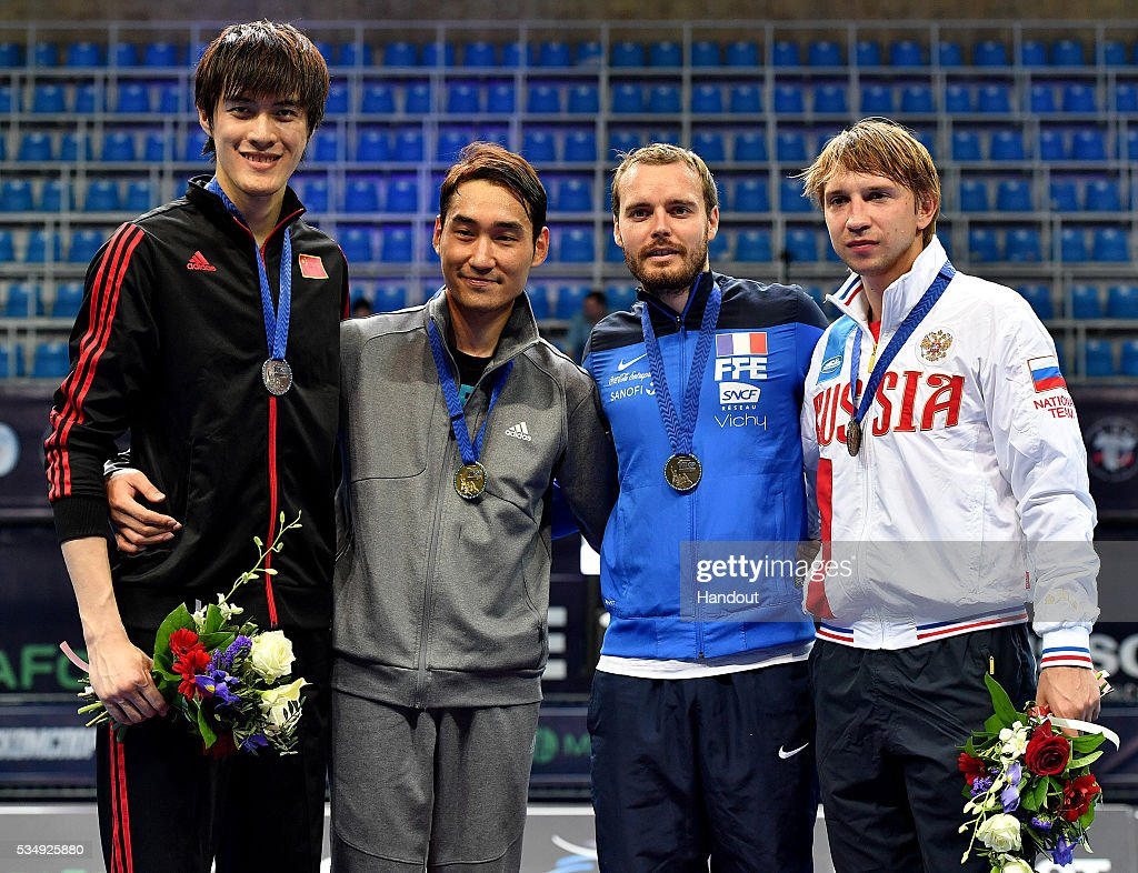 In this handout image provided by FIE, Yingming Xu of China (Silver), Kim Jung-hwan of South Korea (Gold), <a gi-track='captionPersonalityLinkClicked' href=/galleries/search?phrase=Vincent+Anstett&family=editorial&specificpeople=2124773 ng-click='$event.stopPropagation()'>Vincent Anstett</a> of France and Nikolay Anatolyevich Kovalev of Russia (Bronze) pose on the podium after the Men's Individual Sabre competition during the FIE Moscow Grand Prix on May 28, 2016 in Moscow, Russia.