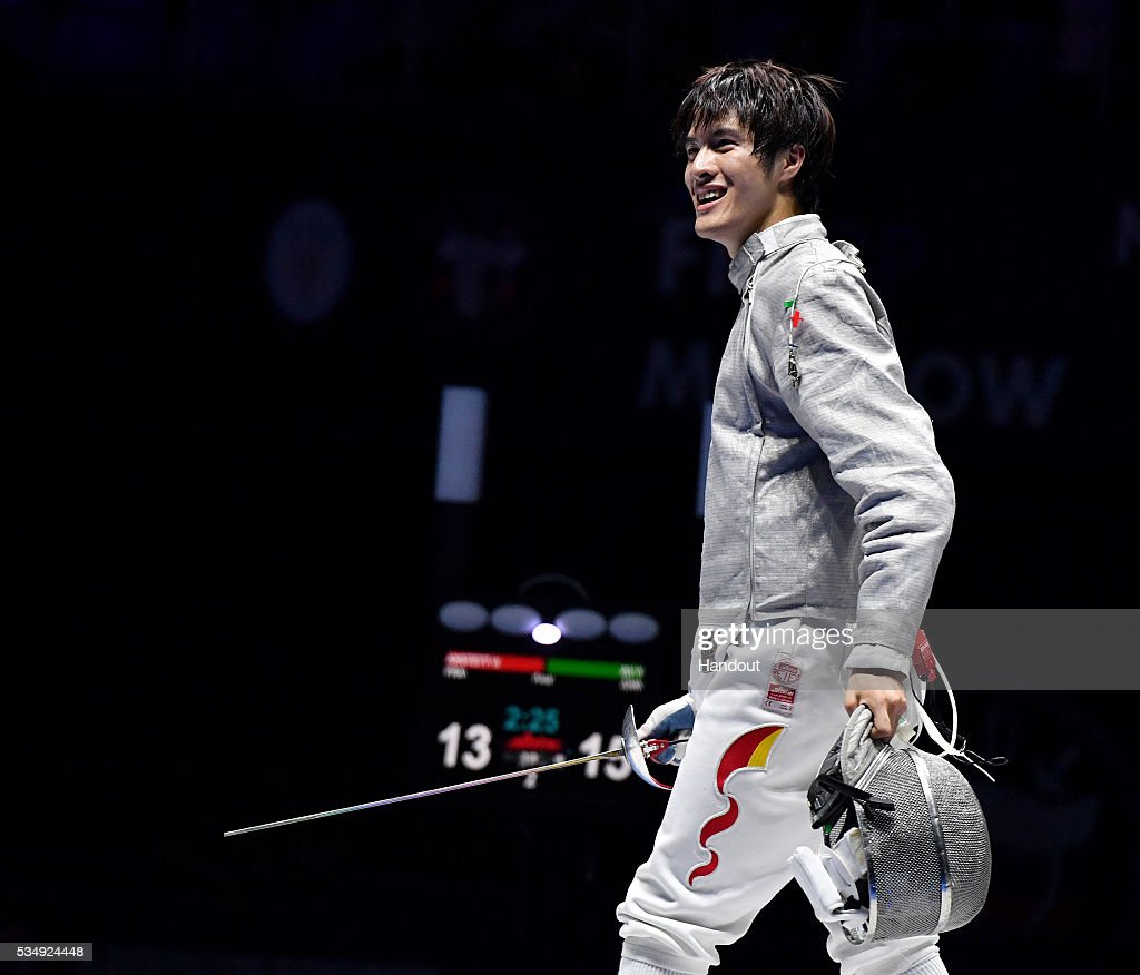 In this handout image provided by FIE, Yingming Xu of China reacts in his Men's Individual Sabre semi-final against Vincent Anstett of France during the FIE Moscow Grand Prix on May 28, 2016 in Moscow, Russia.