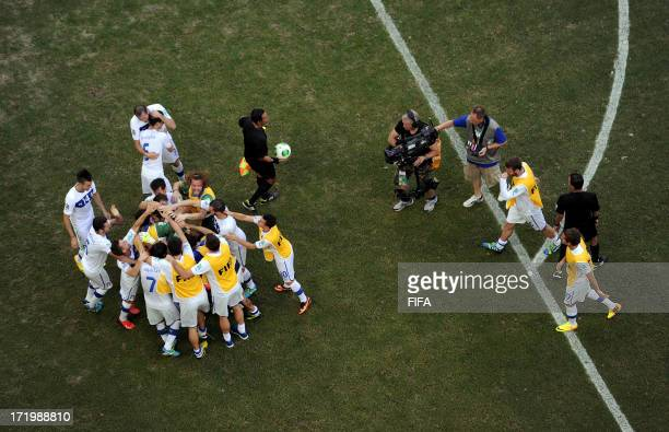 In this handout image provided by FIFA Gianluigi Buffon of Italy celebrates with his teammates after saving the penalty of Walter Gargano of Uruguay...