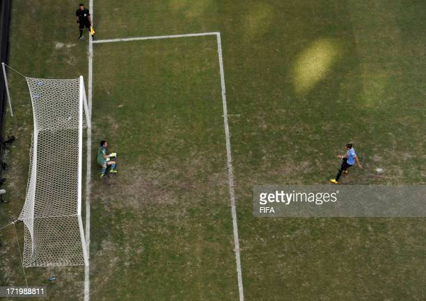 In this handout image provided by FIFA Gianluigi Buffon of Italy saves the penalty of Martin Caceres of Uruguay during a shootout during the FIFA...