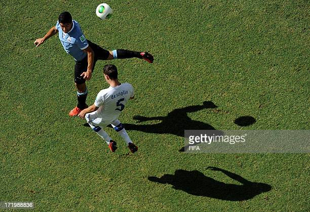 In this handout image provided by FIFA Luis Suarez of Uruguay competes with Mattia De Sciglio of Italy during the FIFA Confederations Cup Brazil 2013...