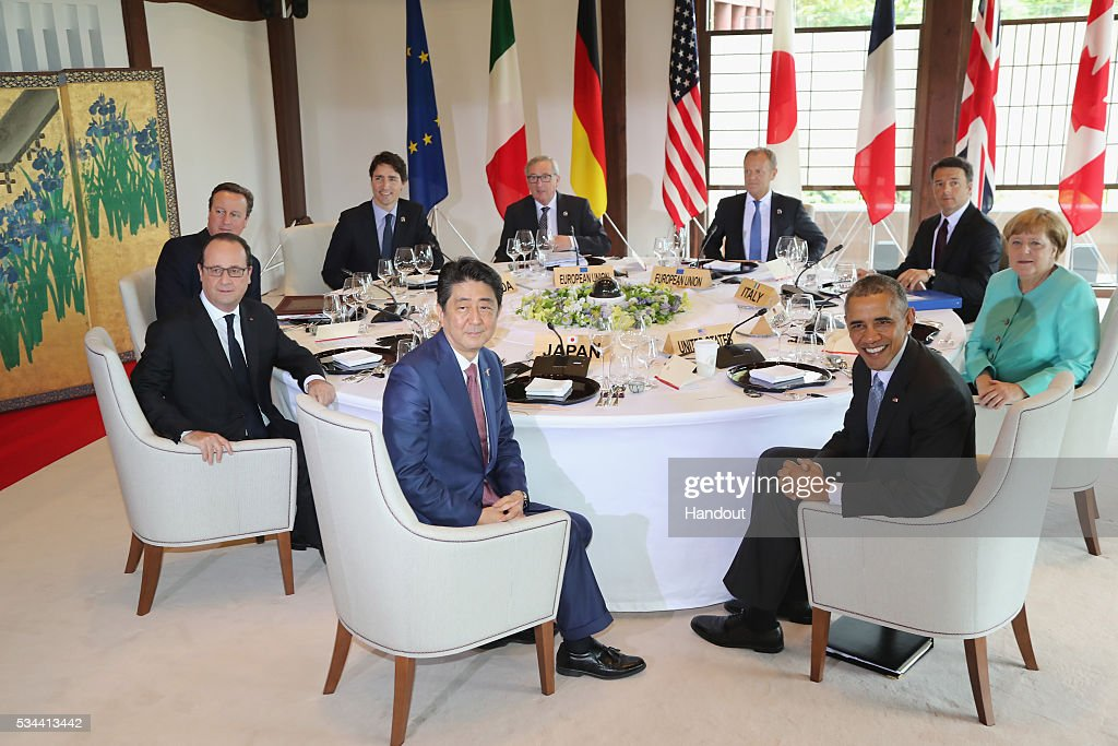 In this handout image provided by Foreign Ministry of Japan, (counter-clockwise from front C) Japanese Prime Minister <a gi-track='captionPersonalityLinkClicked' href=/galleries/search?phrase=Shinzo+Abe&family=editorial&specificpeople=559017 ng-click='$event.stopPropagation()'>Shinzo Abe</a>, U.S. President <a gi-track='captionPersonalityLinkClicked' href=/galleries/search?phrase=Barack+Obama&family=editorial&specificpeople=203260 ng-click='$event.stopPropagation()'>Barack Obama</a>, German Chancellor <a gi-track='captionPersonalityLinkClicked' href=/galleries/search?phrase=Angela+Merkel&family=editorial&specificpeople=202161 ng-click='$event.stopPropagation()'>Angela Merkel</a>, Italian Prime Minister <a gi-track='captionPersonalityLinkClicked' href=/galleries/search?phrase=Matteo+Renzi&family=editorial&specificpeople=6689301 ng-click='$event.stopPropagation()'>Matteo Renzi</a>, European Council President <a gi-track='captionPersonalityLinkClicked' href=/galleries/search?phrase=Donald+Tusk&family=editorial&specificpeople=870281 ng-click='$event.stopPropagation()'>Donald Tusk</a>, European Commission President <a gi-track='captionPersonalityLinkClicked' href=/galleries/search?phrase=Jean-Claude+Juncker&family=editorial&specificpeople=207032 ng-click='$event.stopPropagation()'>Jean-Claude Juncker</a>, Canadian Prime Minister <a gi-track='captionPersonalityLinkClicked' href=/galleries/search?phrase=Justin+Trudeau&family=editorial&specificpeople=2616495 ng-click='$event.stopPropagation()'>Justin Trudeau</a>, British Prime Minister <a gi-track='captionPersonalityLinkClicked' href=/galleries/search?phrase=David+Cameron+-+Politician&family=editorial&specificpeople=227076 ng-click='$event.stopPropagation()'>David Cameron</a> and French President Francois Hollande pose for a photo during the working lunch at the Shima Kanko Hotel on May 26, 2016 in Kashikojima, Japan. In the two-day summit, the G7 leaders are scheduled to discuss the pressing global issues including counter