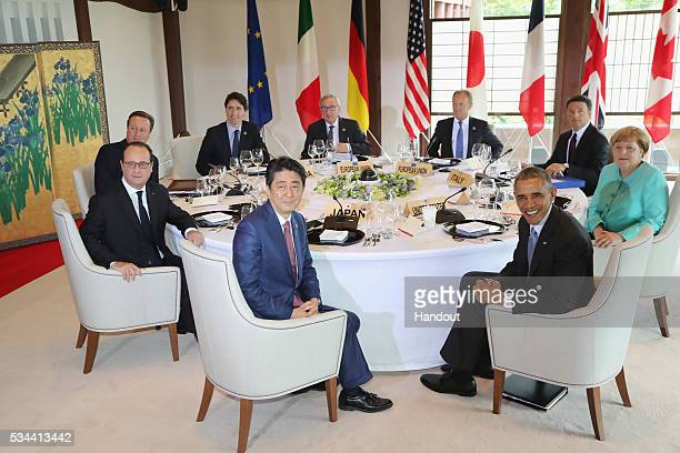 In this handout image provided by Foreign Ministry of Japan Japanese Prime Minister Shinzo Abe US President Barack Obama German Chancellor Angela...
