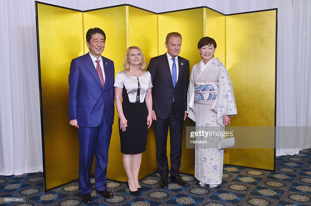 In this handout image provided by Foreign Ministry of Japan, (L-R) Japanese Prime Minister <a gi-track='captionPersonalityLinkClicked' href=/galleries/search?phrase=Shinzo+Abe&family=editorial&specificpeople=559017 ng-click='$event.stopPropagation()'>Shinzo Abe</a>, Malgorzata Tusk, European Council President <a gi-track='captionPersonalityLinkClicked' href=/galleries/search?phrase=Donald+Tusk&family=editorial&specificpeople=870281 ng-click='$event.stopPropagation()'>Donald Tusk</a>, <a gi-track='captionPersonalityLinkClicked' href=/galleries/search?phrase=Akie+Abe&family=editorial&specificpeople=2042808 ng-click='$event.stopPropagation()'>Akie Abe</a> attend the cocktail event during the G7 Japan 2016 Ise-Shima summit at the Shima Kanko Hotel on May 26, 2016 in Kashikojima, Japan. In the two-day summit, the G7 leaders are scheduled to discuss the pressing global issues including counter-terrorism, energy policy, and sustainable development.