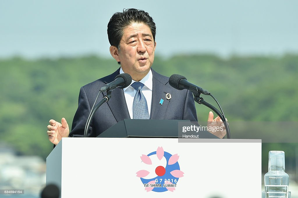 In this handout image provided by Foreign Ministry of Japan Japanese Prime Minister Shinzo Abe speaks during the presidency press conference at the...