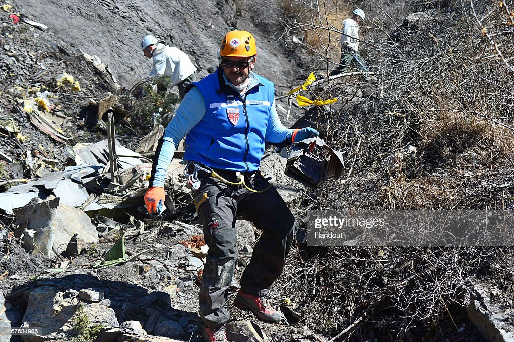 In this handout image provided by French Interior Ministry the Rescue workers and gendarmerie continue their search operation near the site of the...