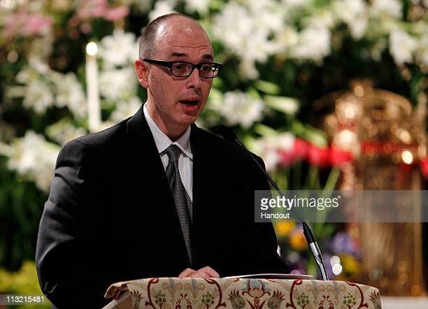 In this handout image provided by Getty Images Pancho Bernasconi Vice President of Editorial at Getty Images speaks at a memorial service for...