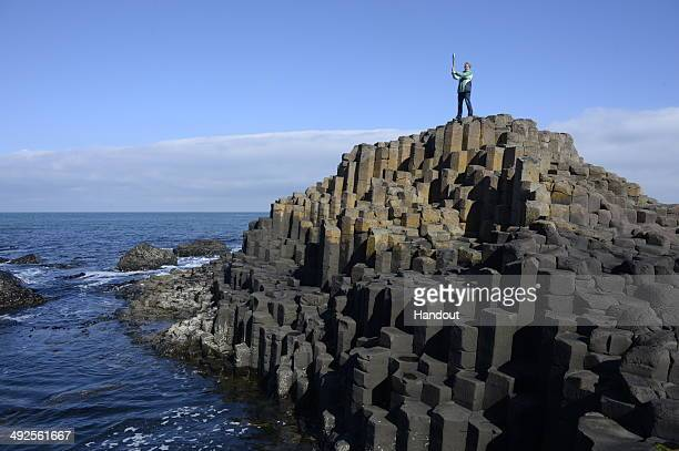 In this handout image provided by Glasgow 2014 Ltd Alison Moffitt holds the Commonwealth Games Baton at the Giants Causeway during the Glasgow 2014...