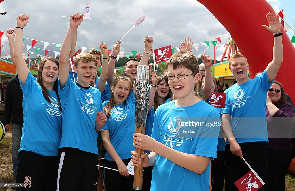 In this handout image provided by Glasgow 2014 Ltd, Jack Freestone fron Conwy carries the Queen's Baton during the annual Welsh language youth festival of literature, music and performing arts during the Glasgow 2014 Baton Relay on May 26, 2014 in Eisteddfod, Wales. Wales is nation 68 of 70 nations and territories the Queen's Baton will visit.