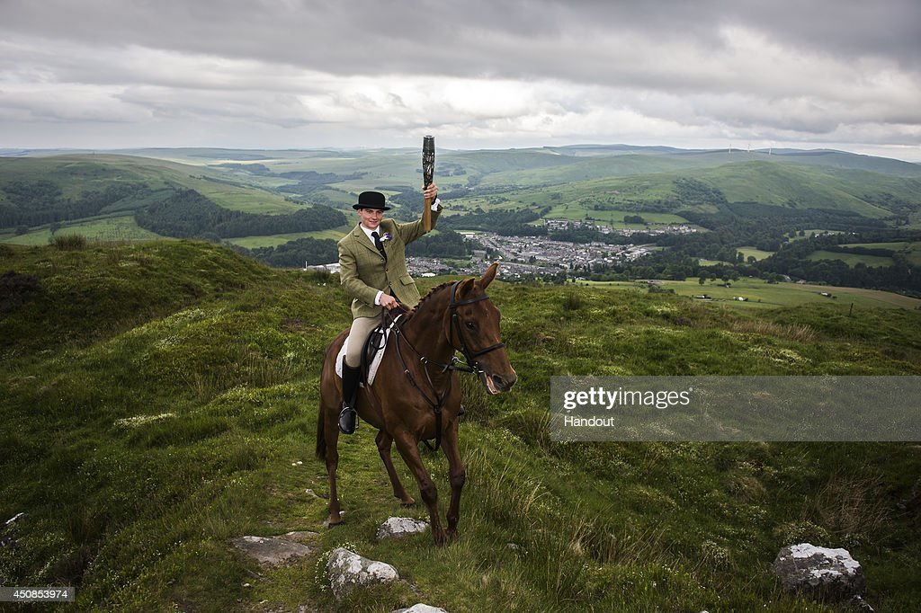 In this handout image provided by Glasgow 2014 Ltd, Riders from the Langholm Cornet relay the Queen's Baton in the hills surrounding Langolm in Dumfries & Galloway during the Glasgow 2014 Queen's Baton relay on June 19, 2014 in Langholm, Scotland. Scotalnd is nation 70 of 70 nations and territories the Queen's Baton will visit.