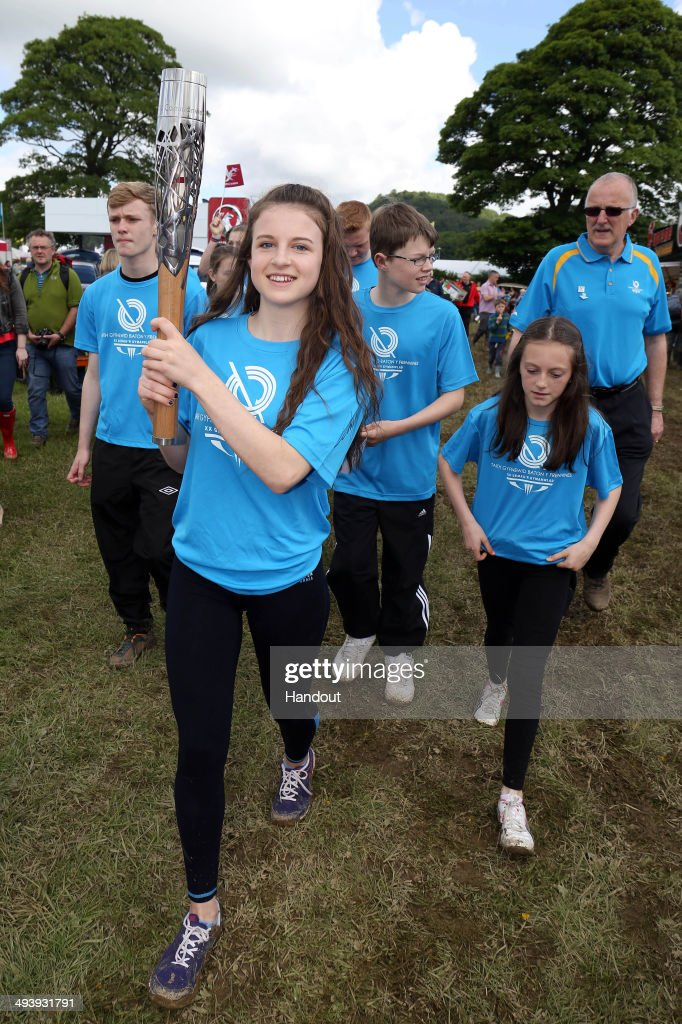 In this handout image provided by Glasgow 2014 Ltd, Siriol Elin Jones, from Abergele Conwy carries the Queen's Baton during the annual Welsh language youth festival of literature, music and performing arts during the Glasgow 2014 Baton Relay on May 26, 2014 in Eisteddfod, Wales. Wales is nation 68 of 70 nations and territories the Queen's Baton will visit.