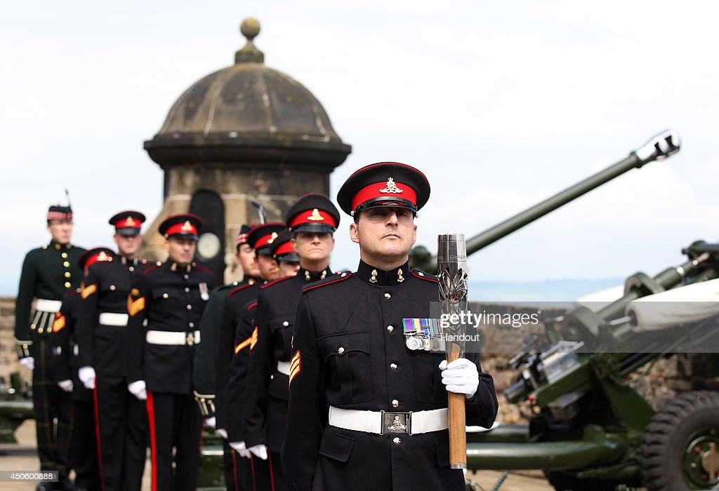In this handout image provided by Glasgow 2014 Ltd, The Glasgow 2014 Queen's Baton arrives at Edinburgh Castle for a 21 gun salute on June 14, 2014 in Edinburgh, Scotland. England is nation 69 of 70 nations and territories the Queen's Baton will visit.